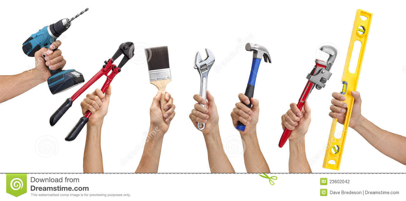 Various tools being held in a mans hand isolated on a white background ...