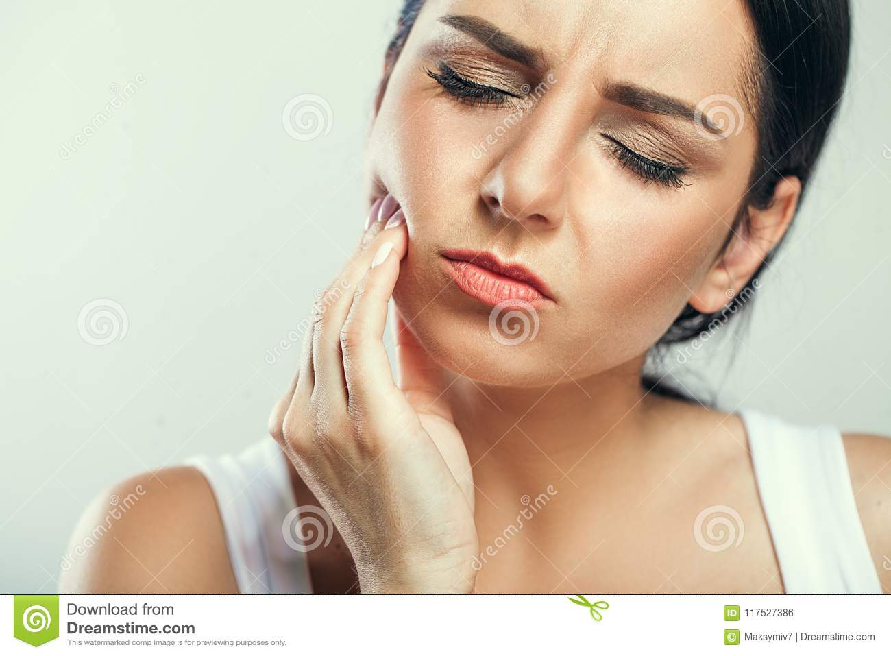 Tooth Pain And Dentistry. Beautiful Young Woman Suffering From T