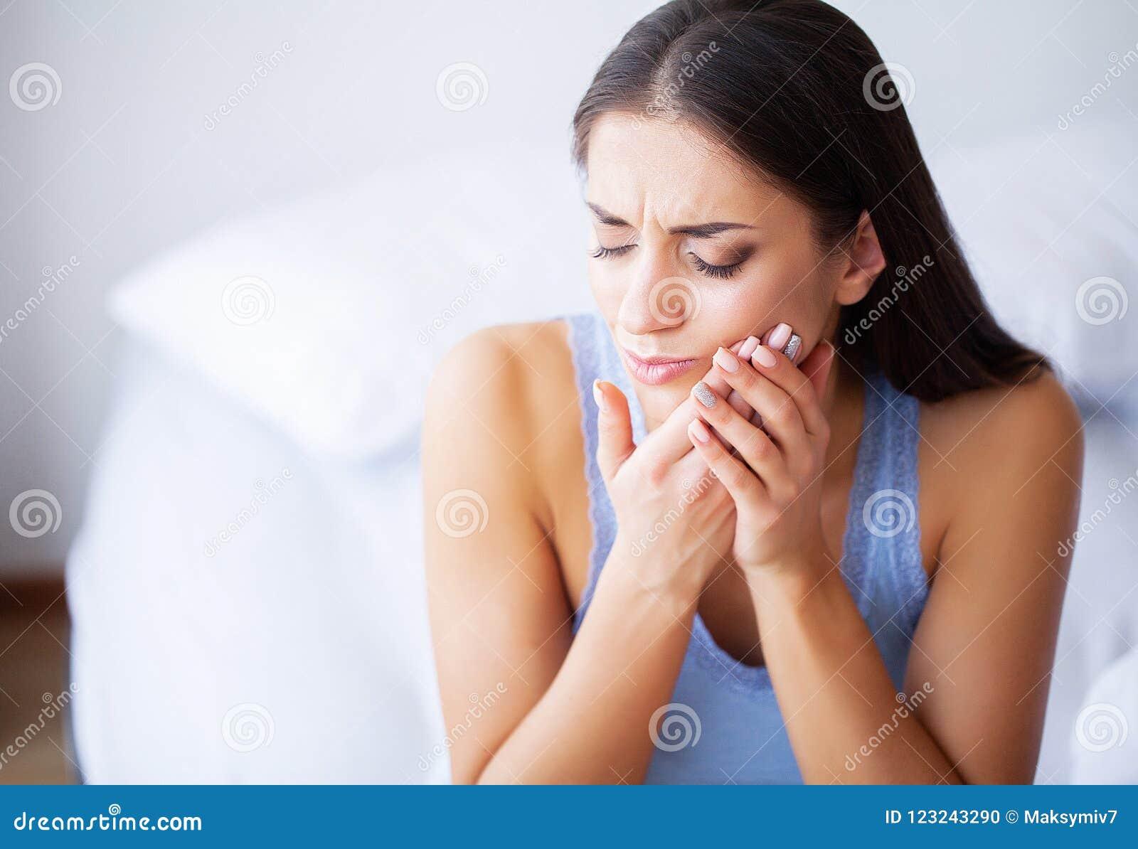 Tooth Pain. Woman Feeling Tooth Pain. Closeup Of Beautiful Sad G