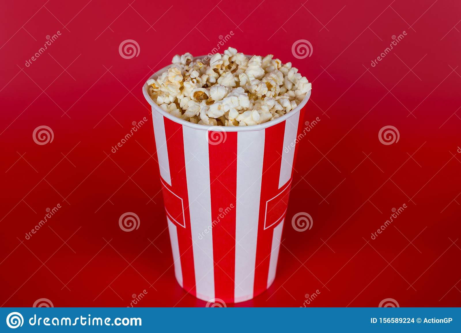 Top above high angle overhead close up view photo of tasty fresh delicious yummy sweet sugary salty popcorn isolated over bright