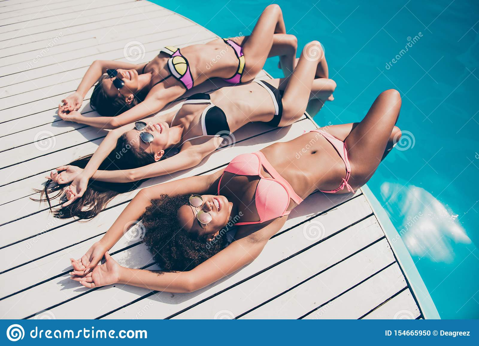 Top above high angle view of nice attractive peaceful slim fit thin sporty graceful girls lying on wood at fashionable