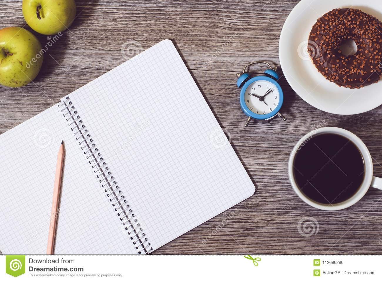 Top above overhead close up view photo of open diary notebook notepad book writing pen pentic for making notes green fresh fruit a