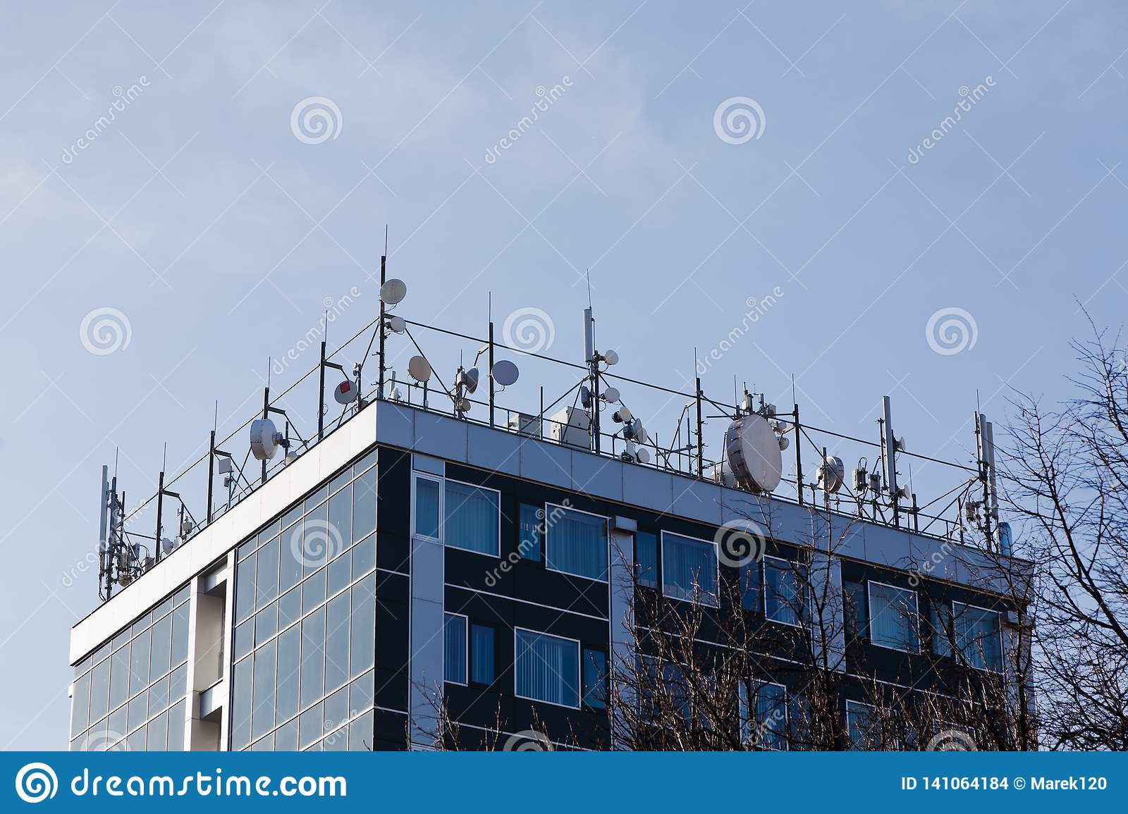 Top of building full of satellites and microwaves connections - Stay tuned