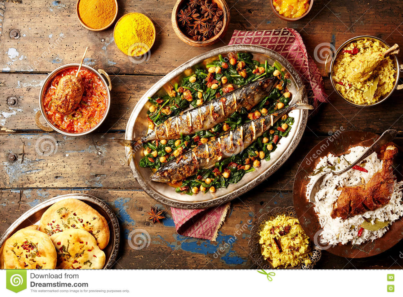 Top down view on baked fish indian style