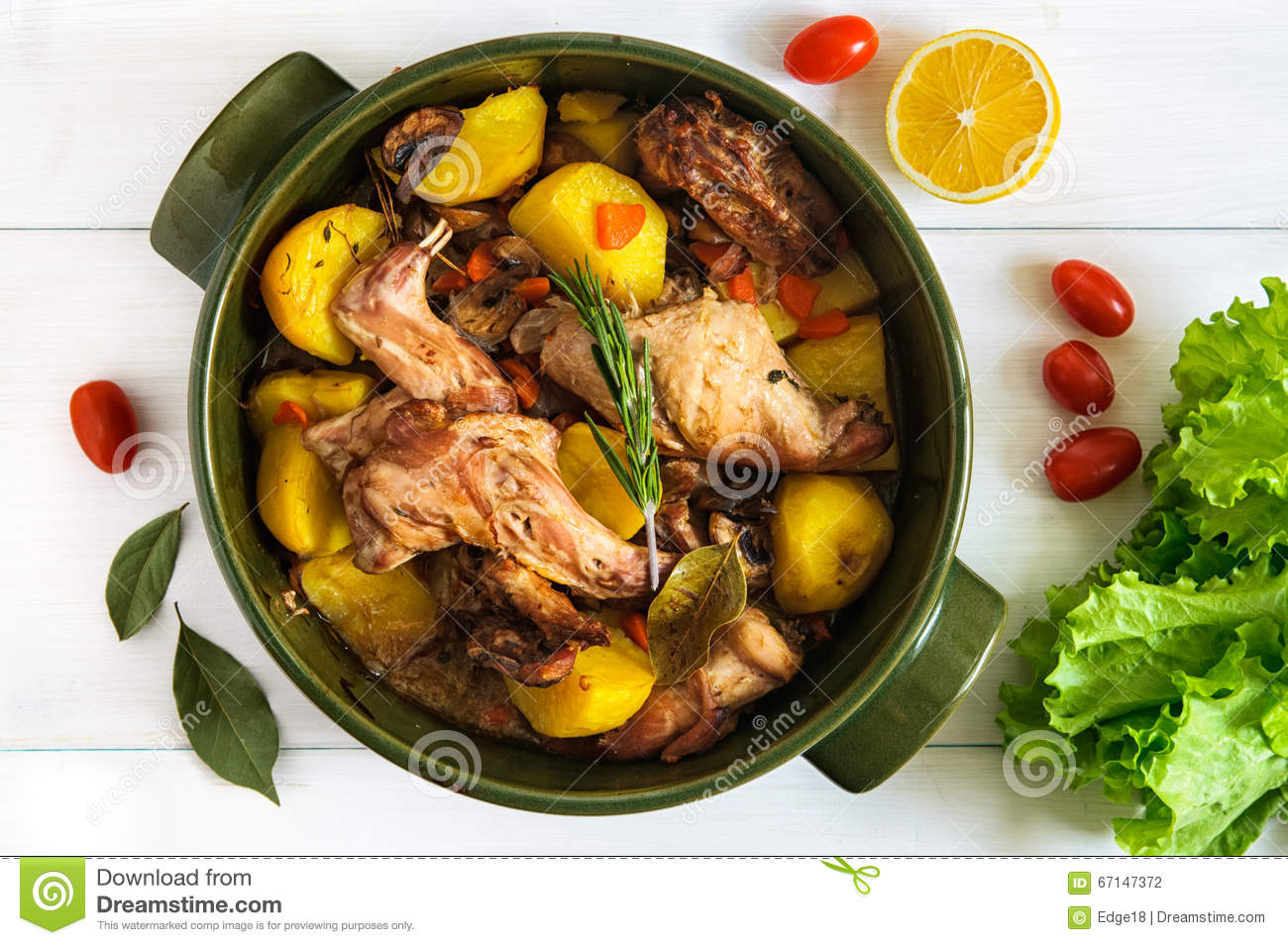 Download Top Flat View Of Roasted Rabbit Meat With Vegetables In Round Ceramic Pot On White Wooden Table Surface. Food Stock Photo - Image of recipe, herbs: 67147372