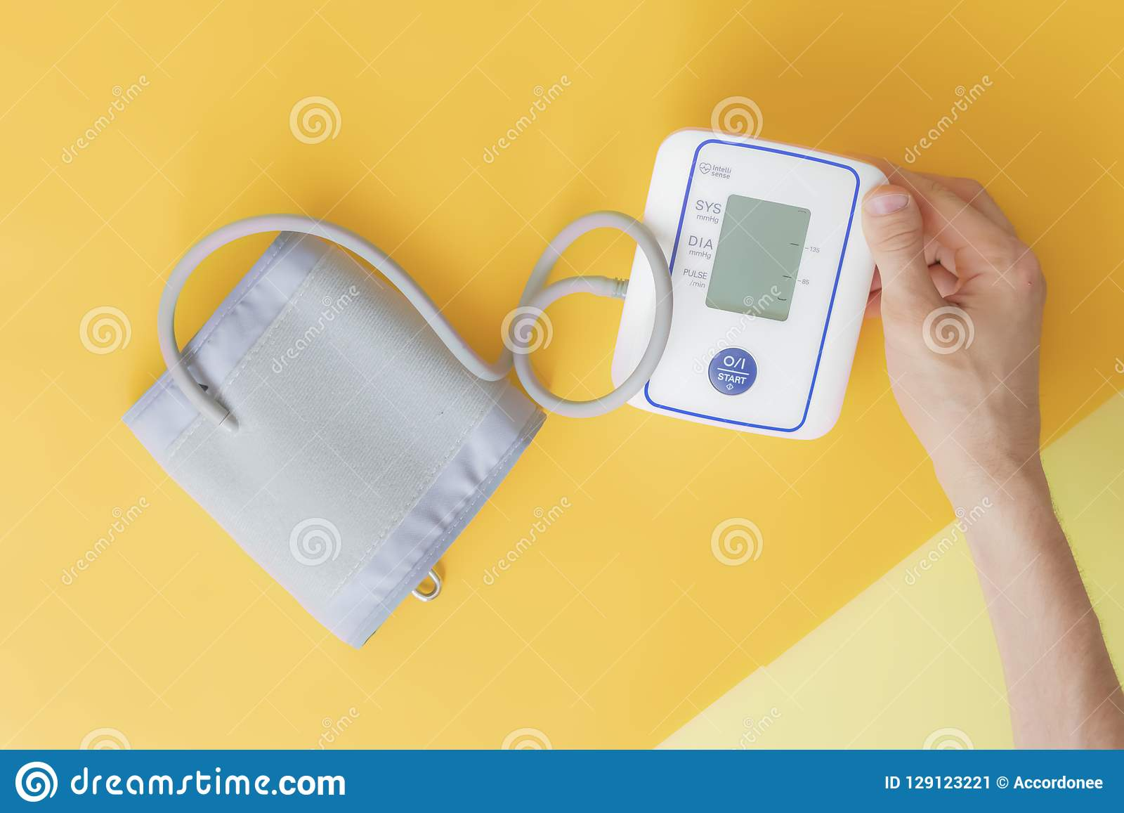 Top overhead view of hands using tonometer isolated on colo surface background creative d