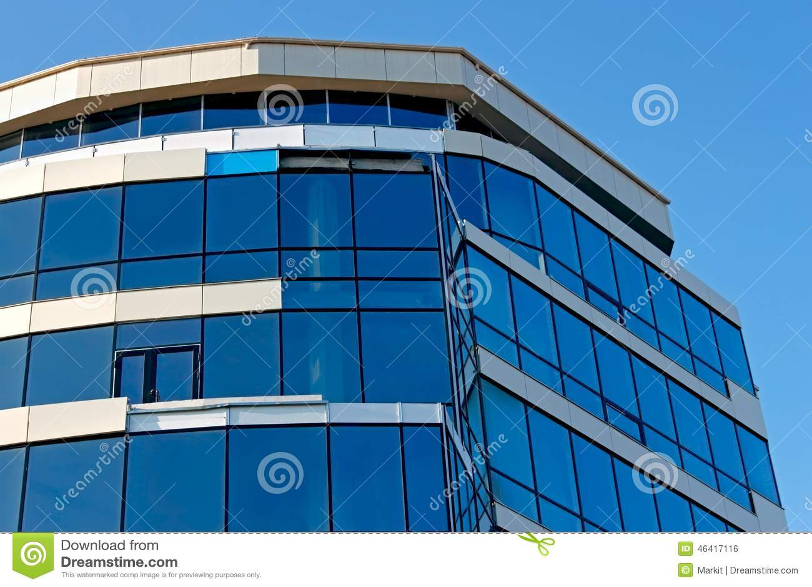 top part of the modern office building construction blue glass top modern office