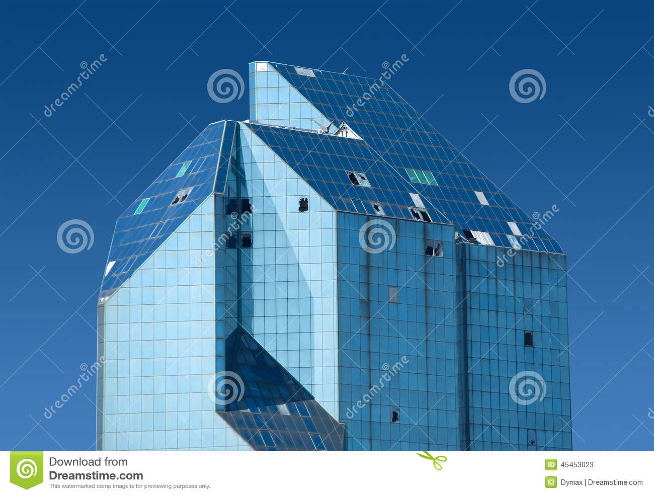 top section of modern office building of glass and metal with some broken windows blue glass top modern office