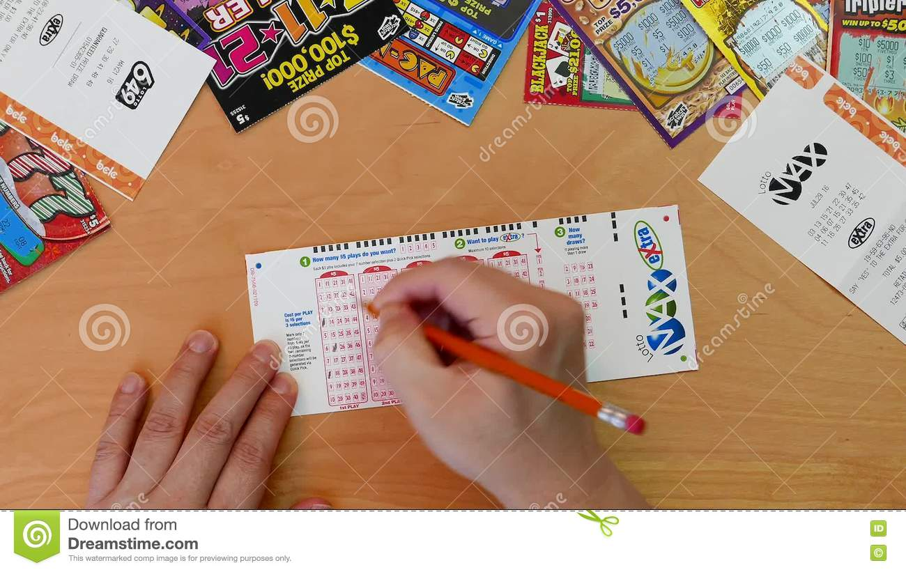 Top Shot Of Man Filling Lucky Number On Lotto Max Ticket