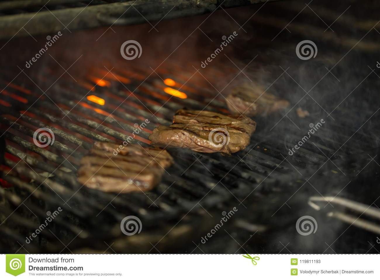 A top sirloin steak flame broiled on a barbecue