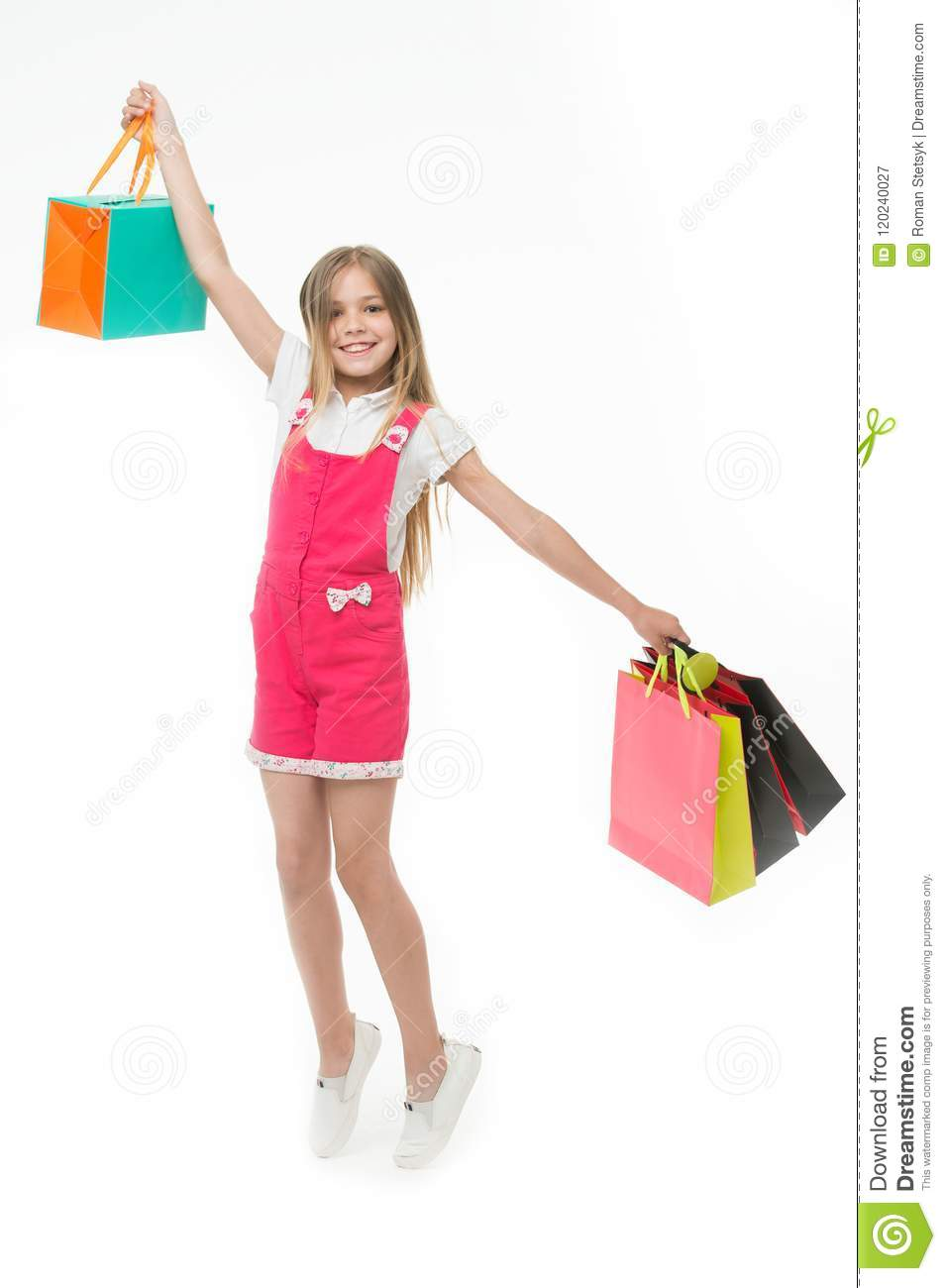 Top tips for smart kid clothes shopping. Girl cute teenager carries shopping bag. Kid bought clothing summer sale