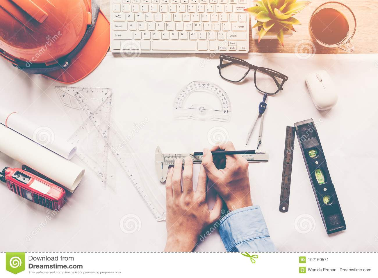 Top view architect working on blueprint architects workplace top view architect working on blueprint architects workplace engineer tools and safety control blueprints ruler orange helmetradiolaptop and divider malvernweather Gallery
