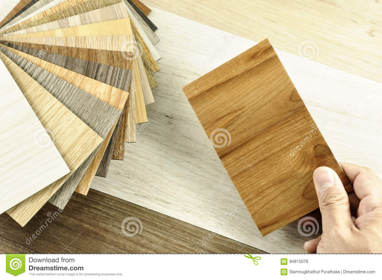 Top view of Architects & Interior designers hands pick up material on table in workplace in the morning. home renovation concept