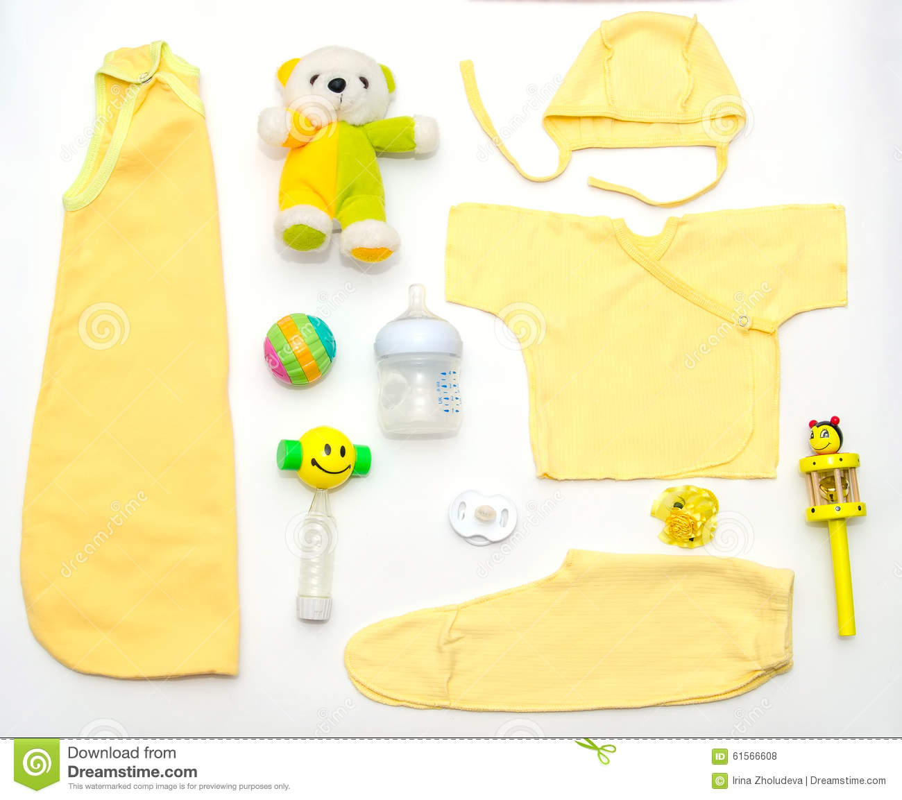 Top View Baby Girl Yellow Clothes And Toy Stuff Stock