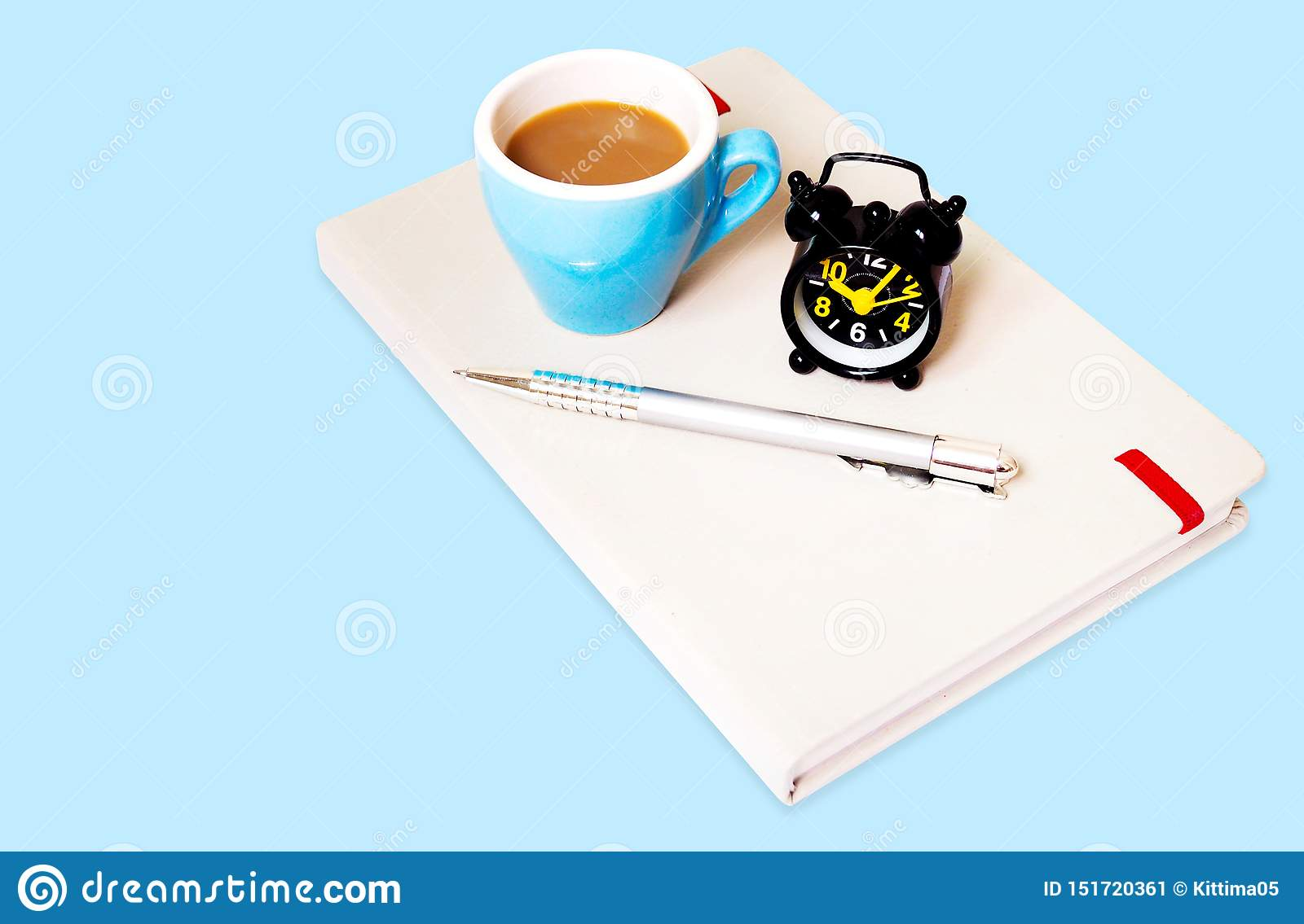 top view of background template design with coffee mug alarm clock and notebook on blue paper stock image image of empty creativity 151720361 https www dreamstime com top view background template design coffee mug alarm clock notebook blue paper equipment working pens notebooks image151720361