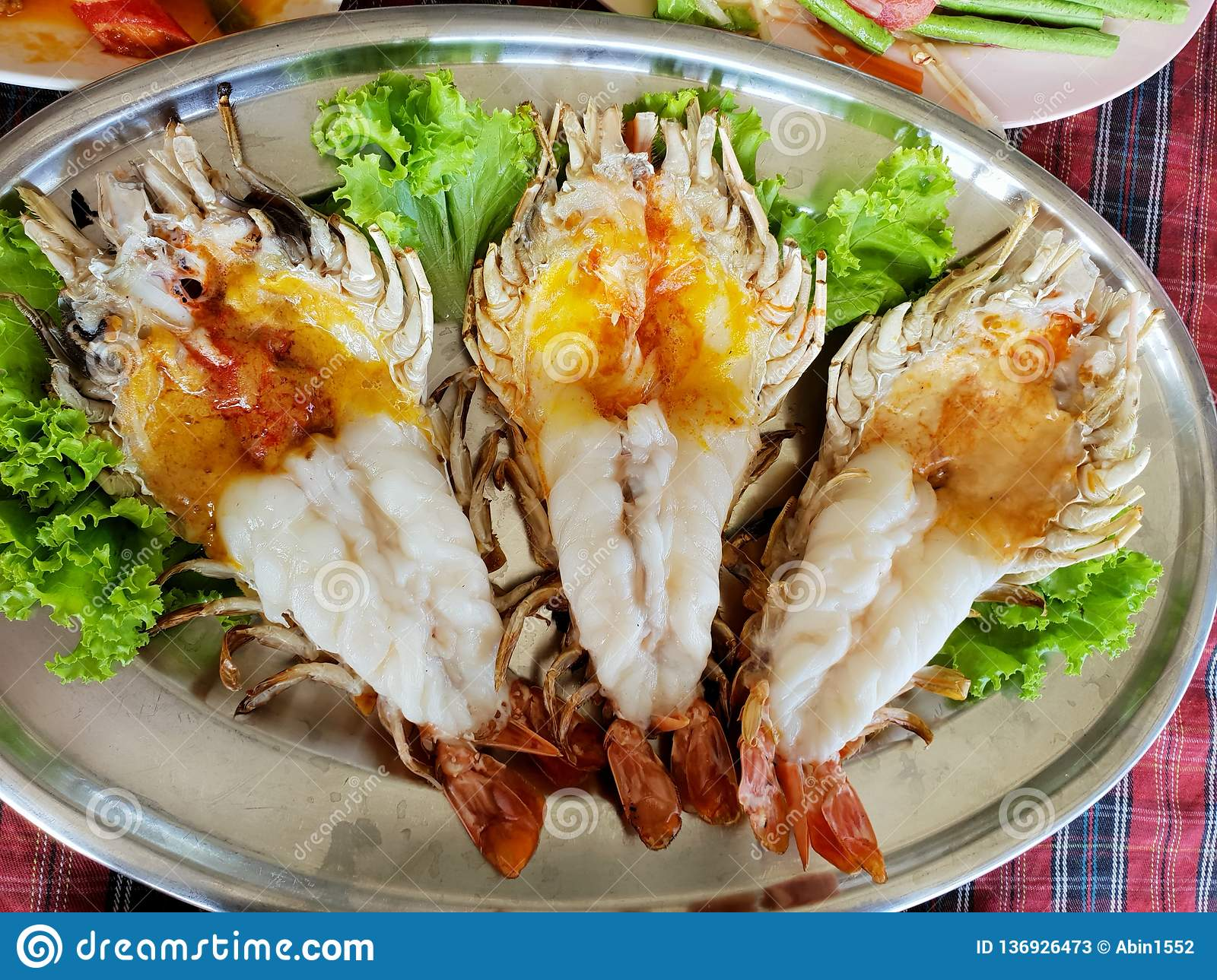Top view of barbecued shrimp on tray in restaurant, Grilled giant river prawn as a background.