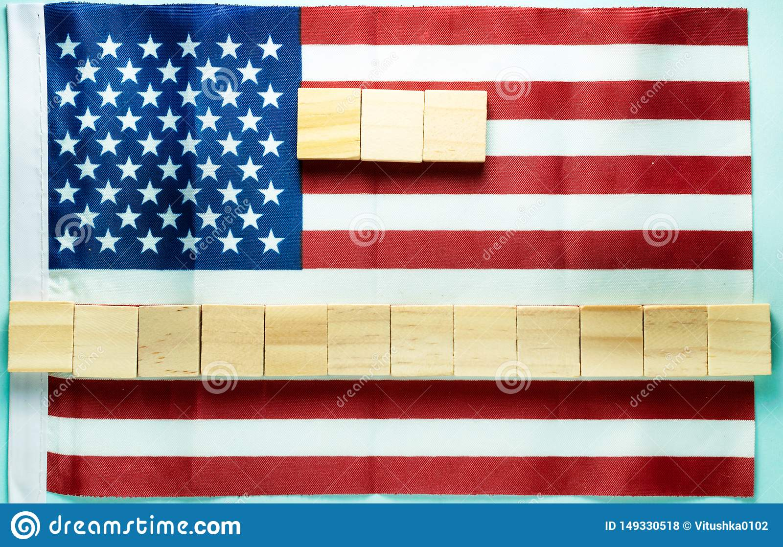 blank for inscription on fifteen wooden cubes laid out on American flag