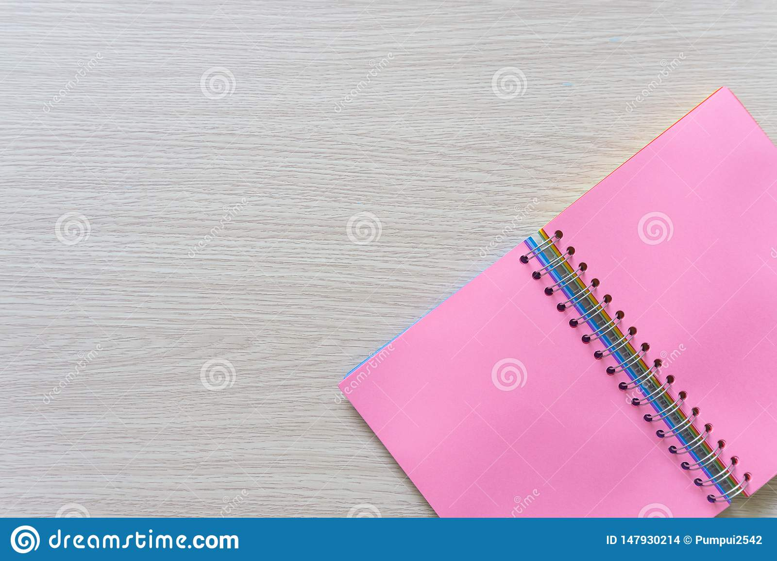 Top view of Blank notebook on wood background with copy space