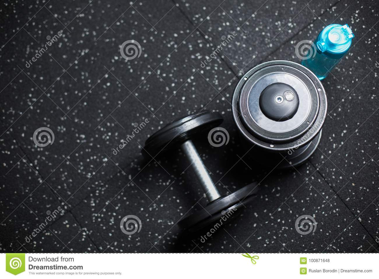 Top View Of Two Metal Dumbbells And A Bottle For Water, Equipment