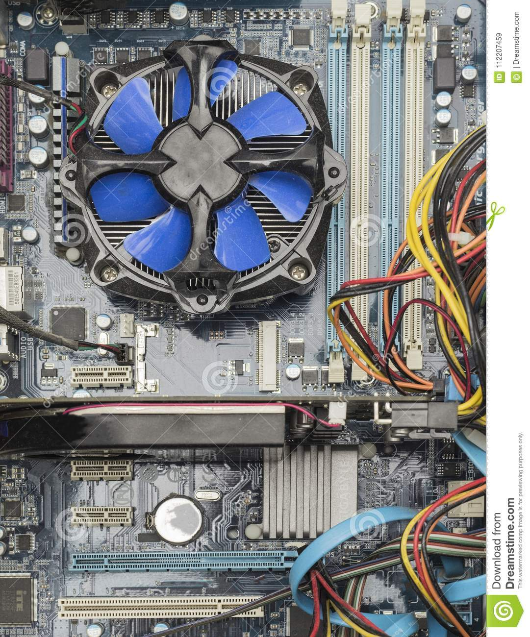 Top view of blue cpu fan and Video Card on motherboard.