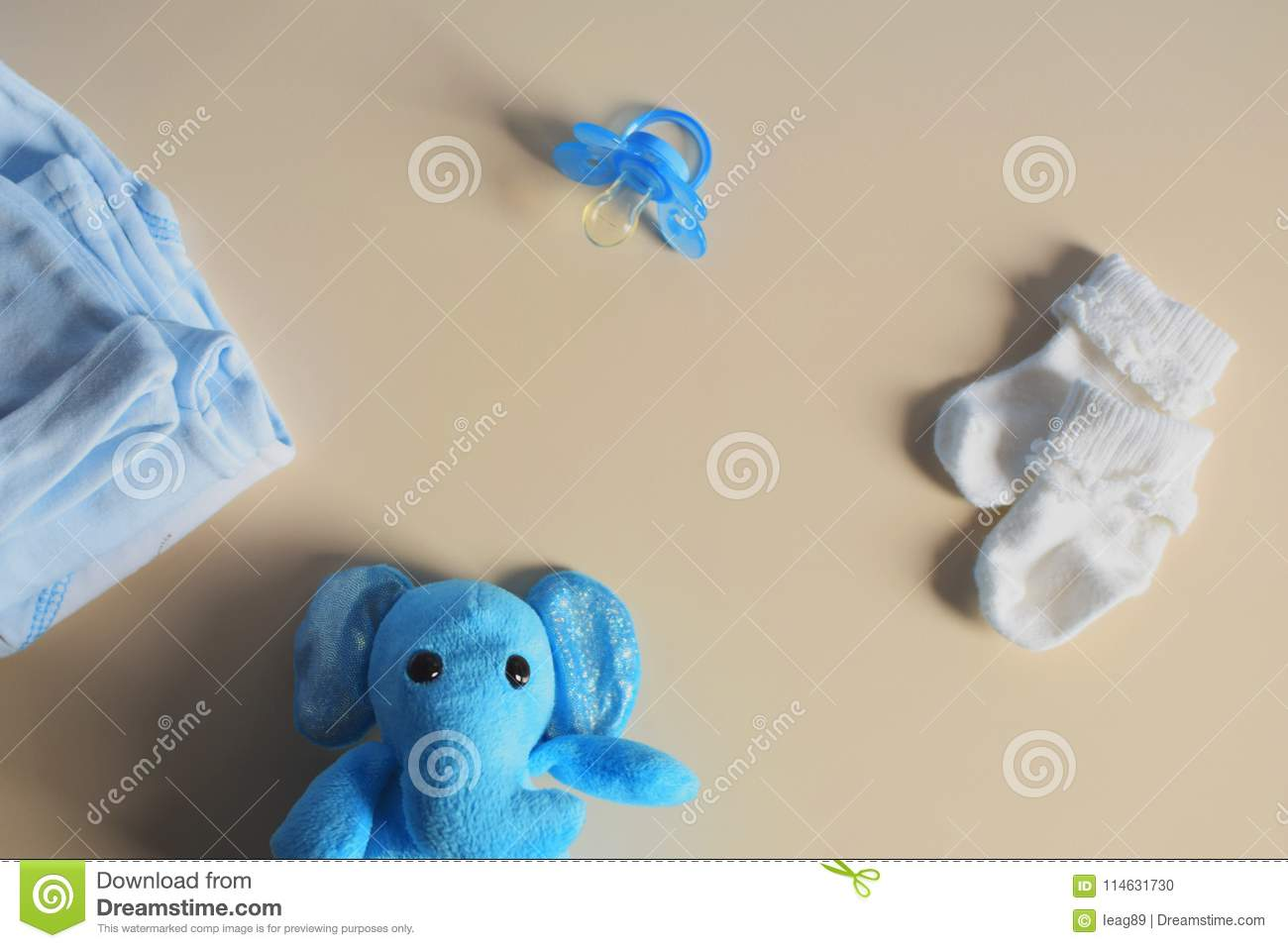 Blue toy elephant and baby clothes