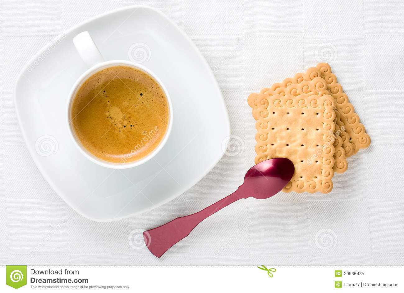 Top view of breakfast with cup of espresso coffee and biscuits.