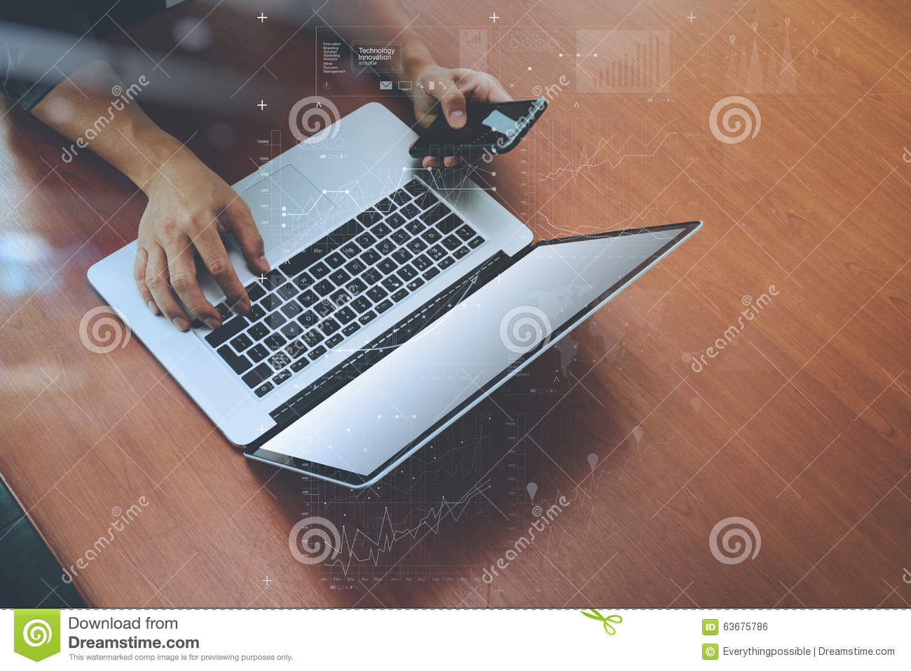 Top view of businessman hand using on smart phone and laptop
