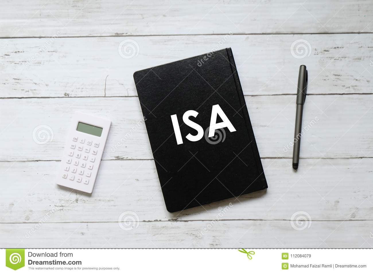 Top view of calculator,pen and notebook written with ISA & x28;individual saving account& x29; on white wooden background