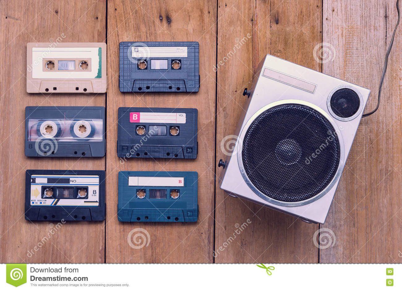 Top view Cassette tape and speaker laying on wood