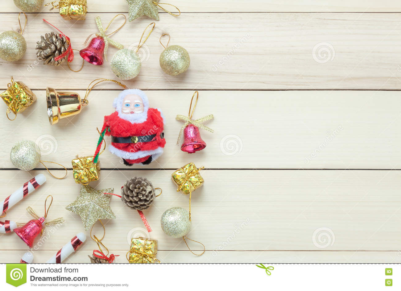Top view Chrismas decoration and Santa Claus doll on wooden table with copy space.