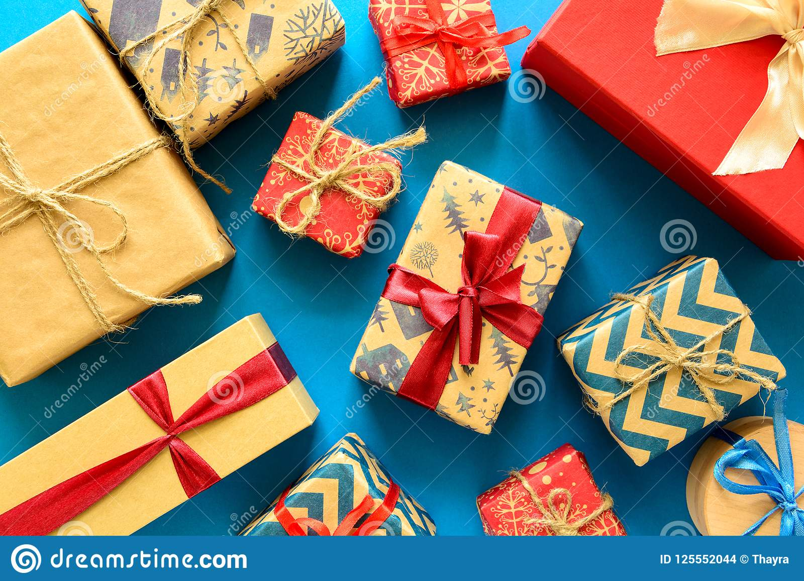 Top View On Christmas Gifts Wrapped In Gift Paper Decorated With ...