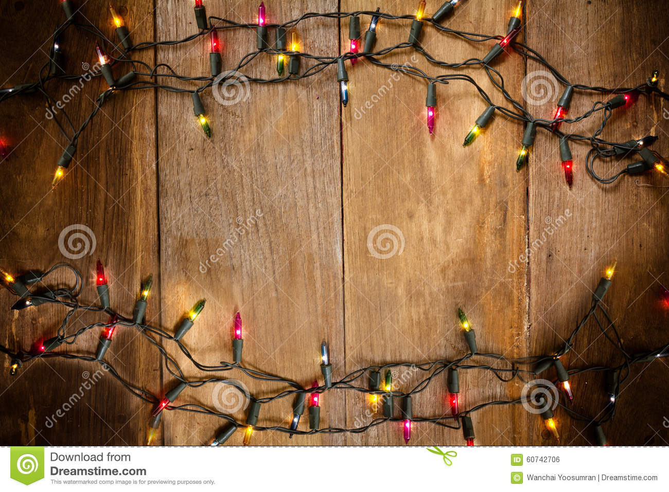 Top view, Christmas and New Year lights on old wood background