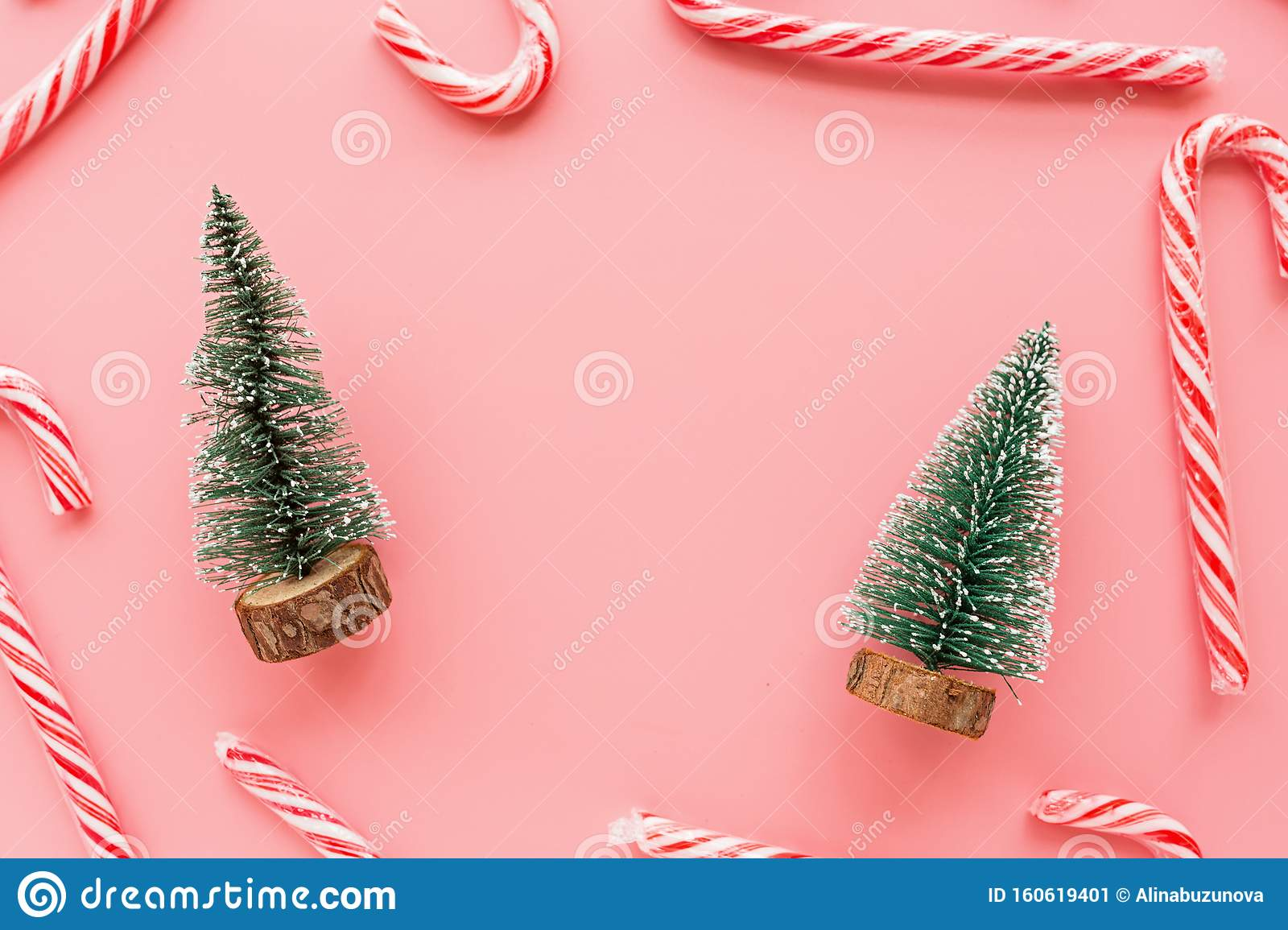 Top View Of Christmas Tree With Many Candy Canes On Pastel Pink Background Holiday Festive Celebration Greeting Card With Copy Stock Image Image Of Holiday Cane 160619401