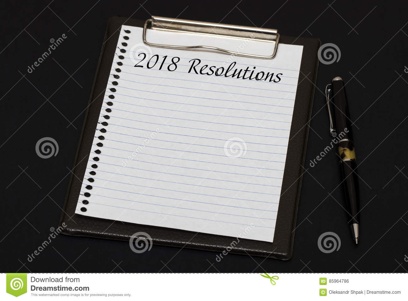 top view of clipboard and white sheet written with 2018 resoluti