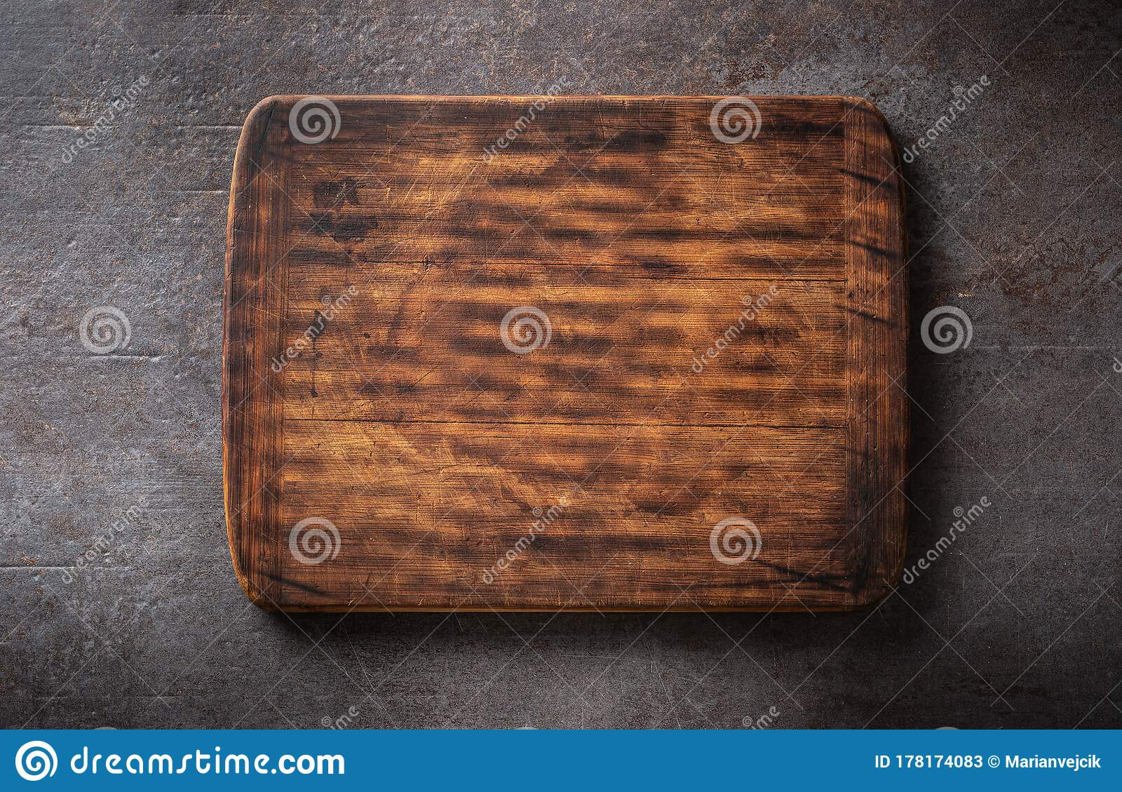 Top View Of Dark Brown Empty Rustic Wooden Rectangular Cutting Board With Rounded Edges On A Black Metallic Background Stock Image Image Of Equipment Desk 178174083