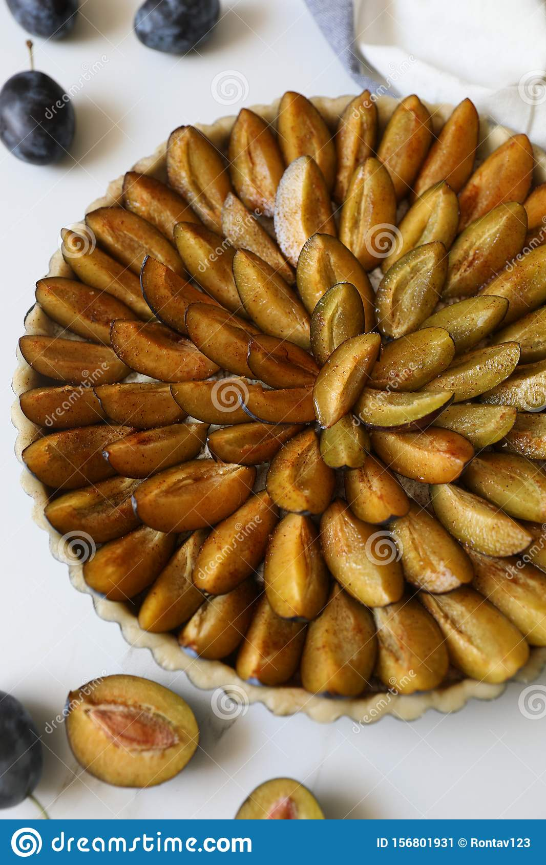 Top view of delicious Traditional Alsatian Plum tart French: Tarte aux quetsches alsacienne
