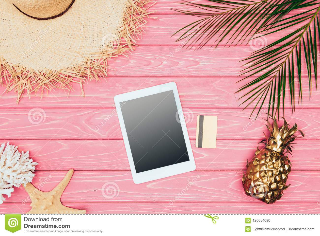 Ananas Credit top view of digital tablet with credit card and golden pineapple on