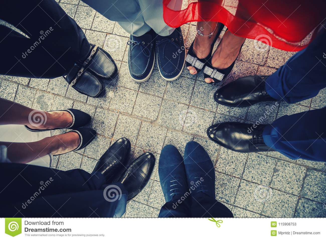 Top view of feet of fashionable, stylish people standing in a circle