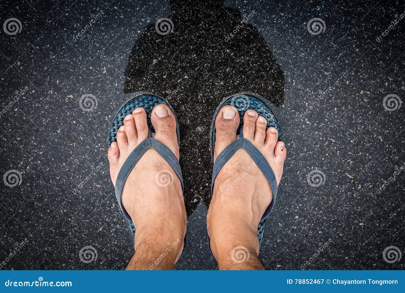 top view feet in sandals selfie shot of asian men legs with wet