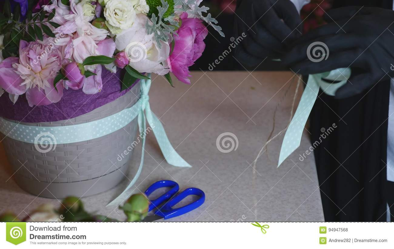 Top View Of Florist Hands Making Flower Bouquet With Decorative