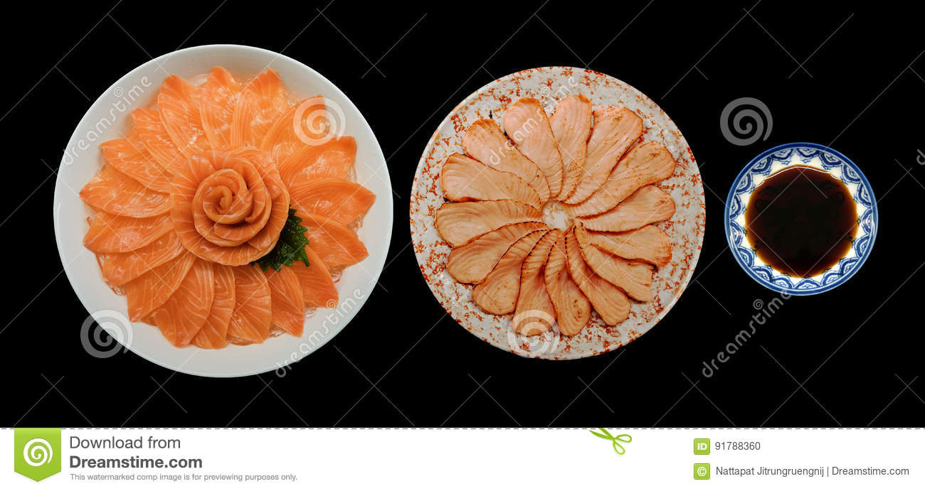 Top view of fresh salmon and grill sashimi and shoyu serve on flower shape in white ice bowl boat isolated on black background, Ja