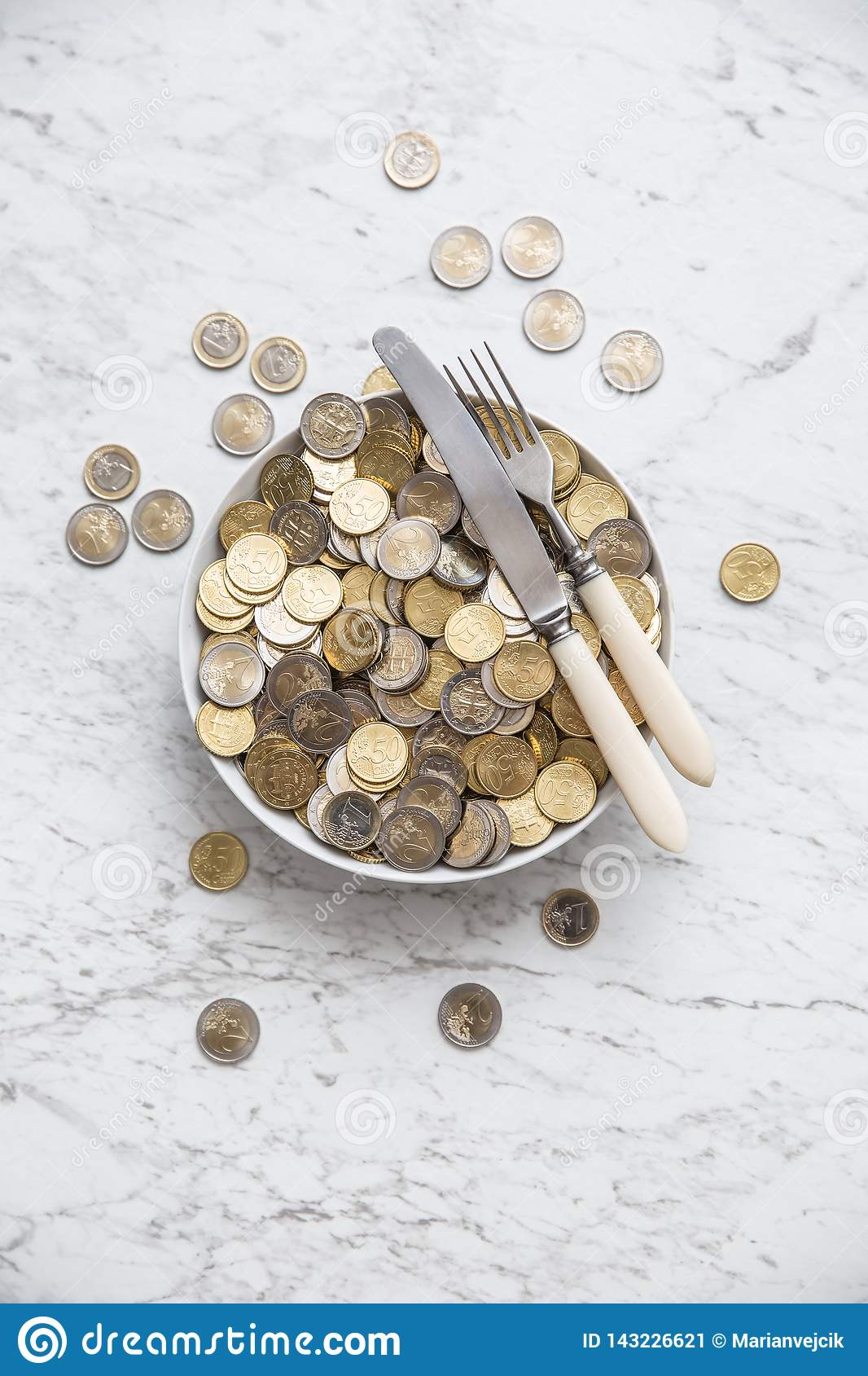 Top of view full plate of euro coins on marble table