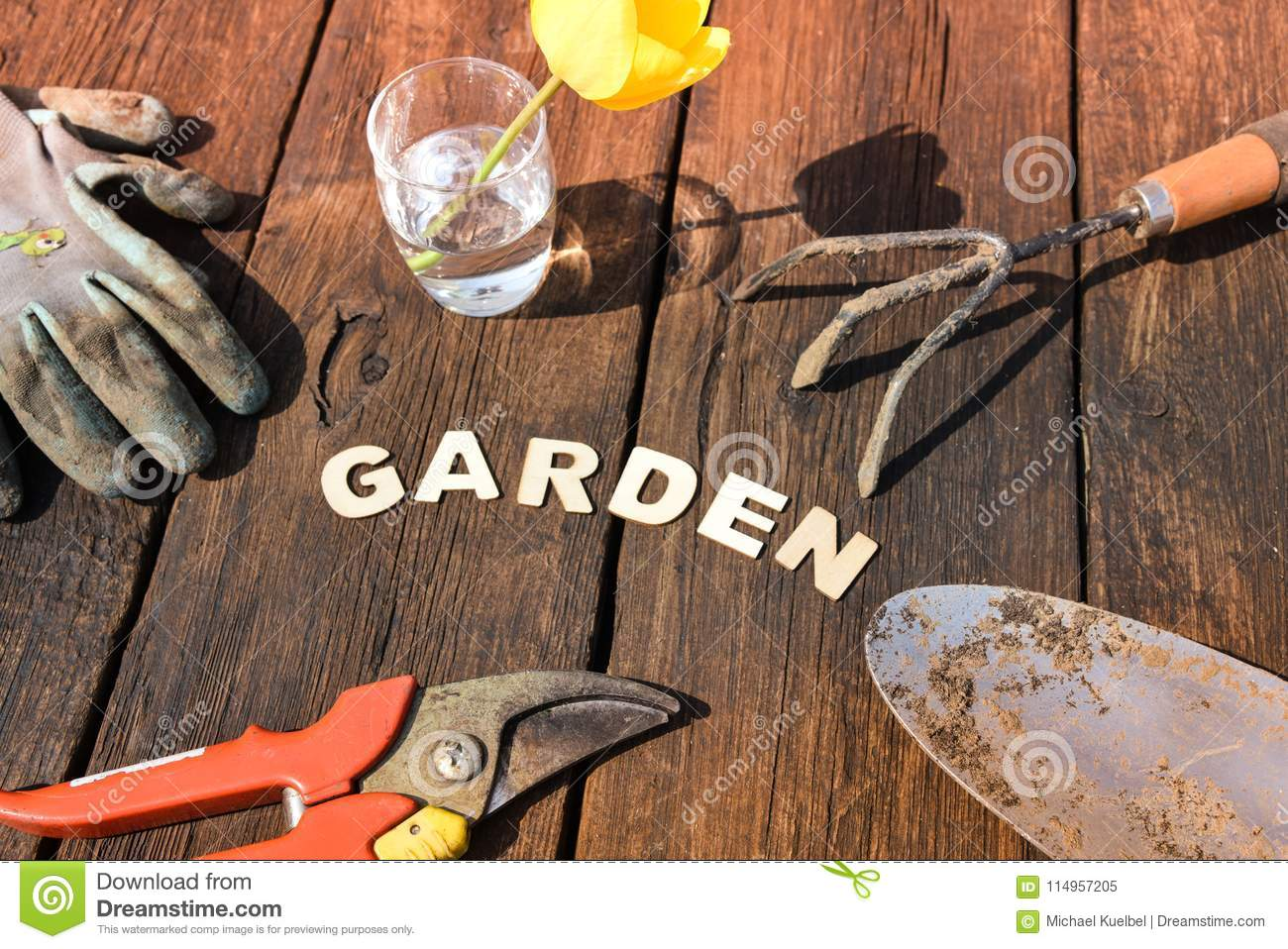 Top View Of Gardening Stuff And Letters Garden On Wooden Background ...