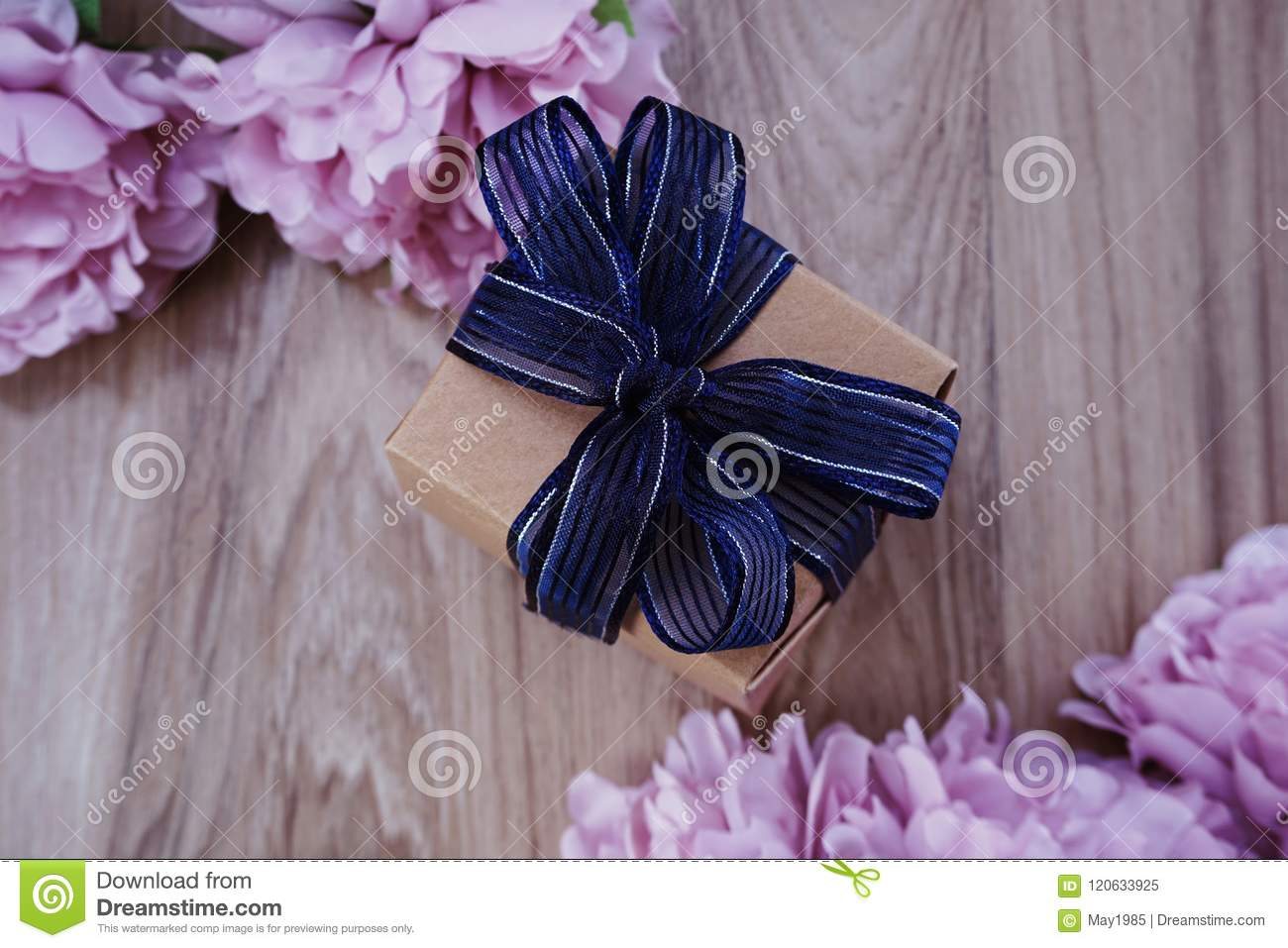 Gift box present with blue ribbon and flower bouquet on space wooden download gift box present with blue ribbon and flower bouquet on space wooden background stock image izmirmasajfo
