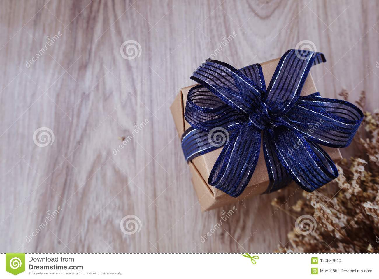 Gift box present with blue ribbon and flower bouquet on space wooden gift box present with blue ribbon and flower bouquet on space wooden background izmirmasajfo