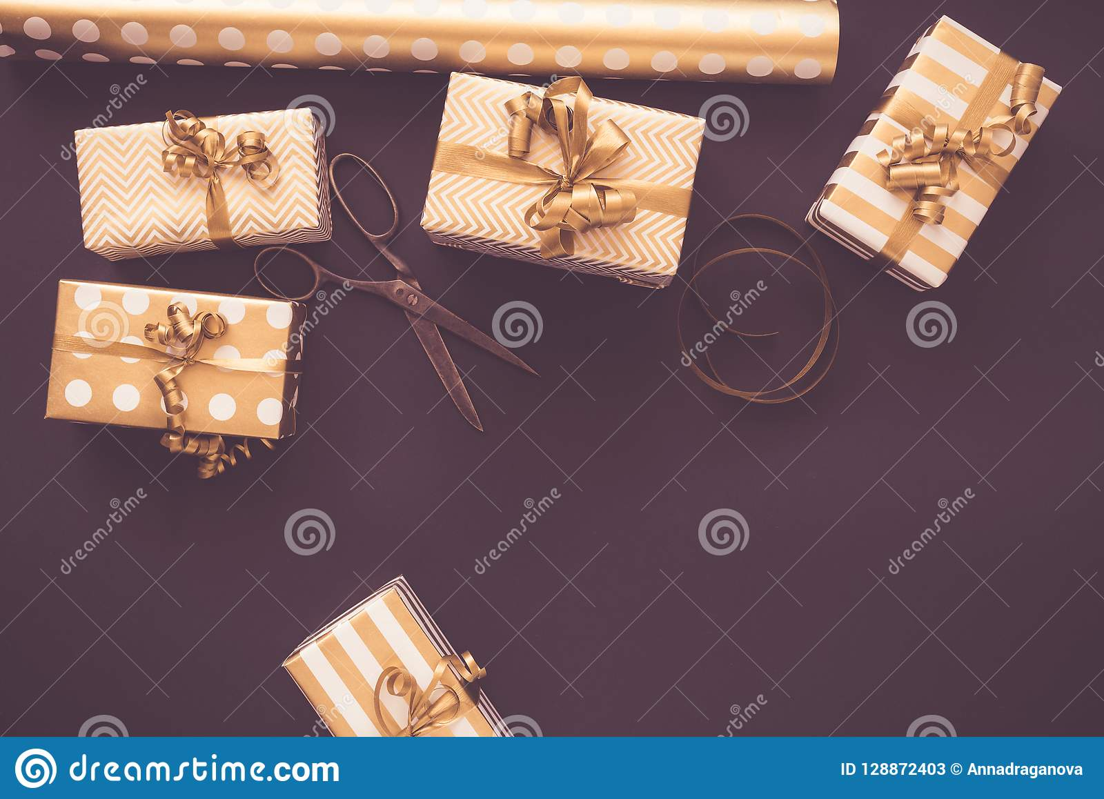 Top view of gift boxes in golden designs. Flat lay, copy space. A concept of Christmas, New Year, birthday celebration