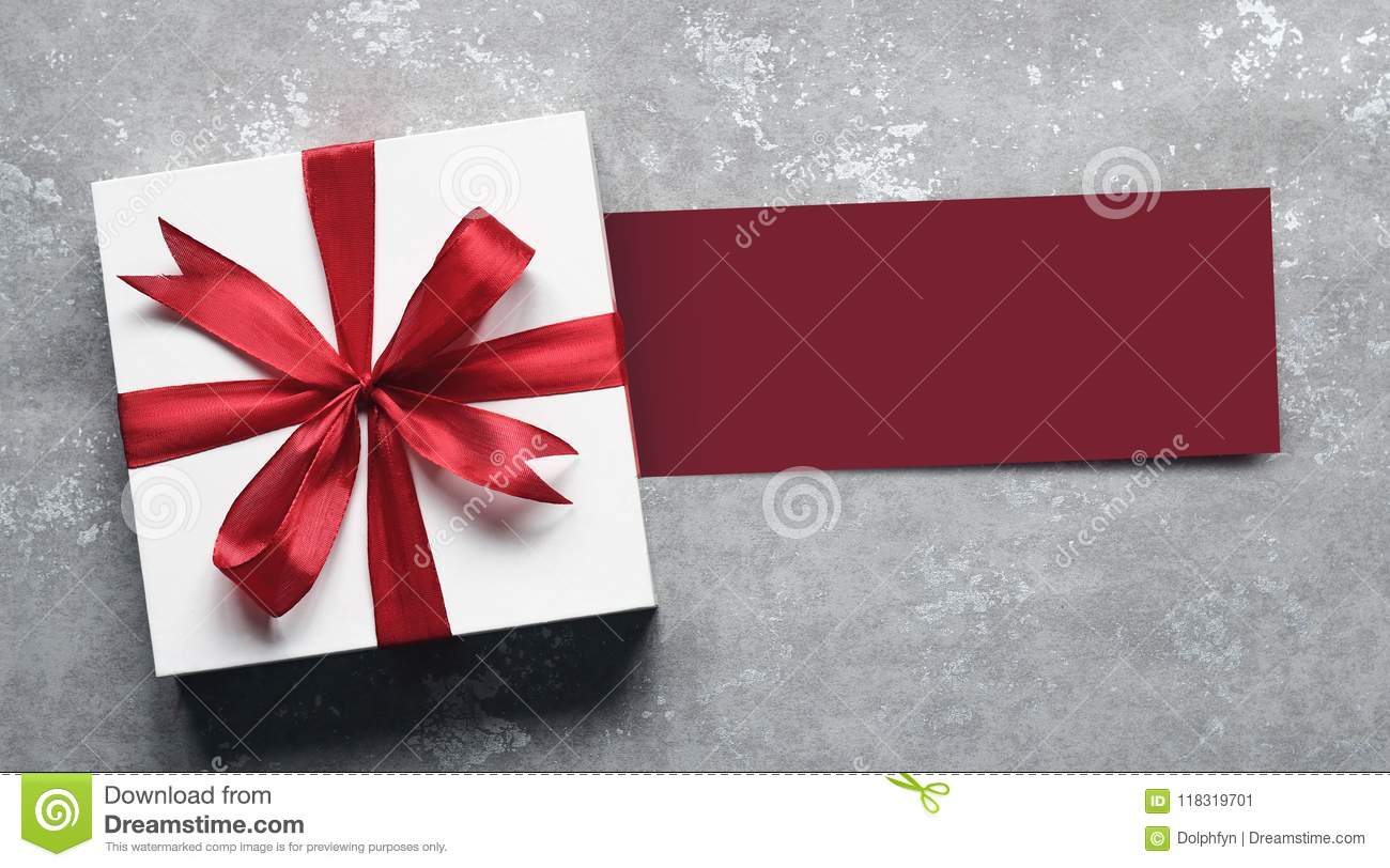 Top View Of Giftbox With Greeting Card On Simple Background Stock