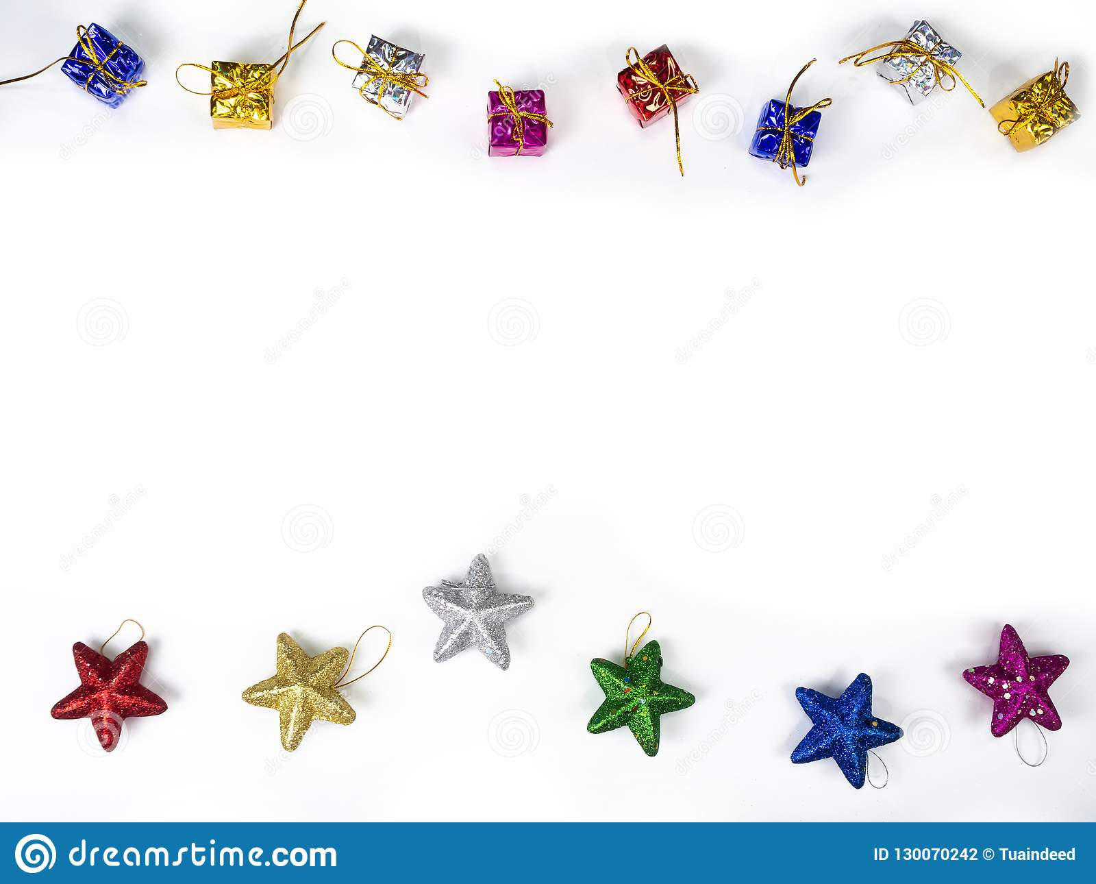 Top view of gifts and star border on white background. Christmas holiday concept