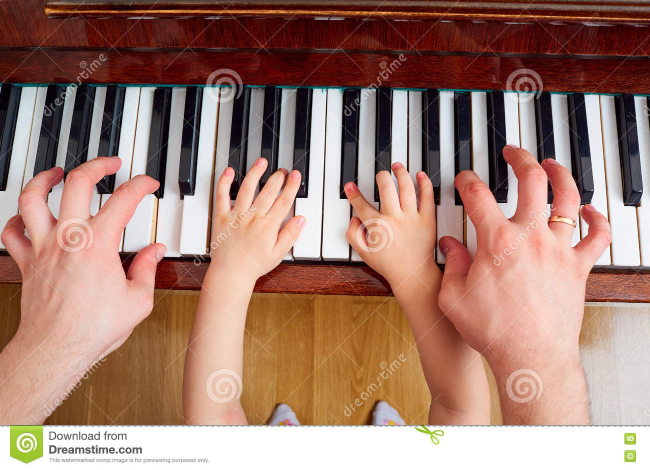 Top View Of A Hand, A Child Piano Keyboard  Small Child's