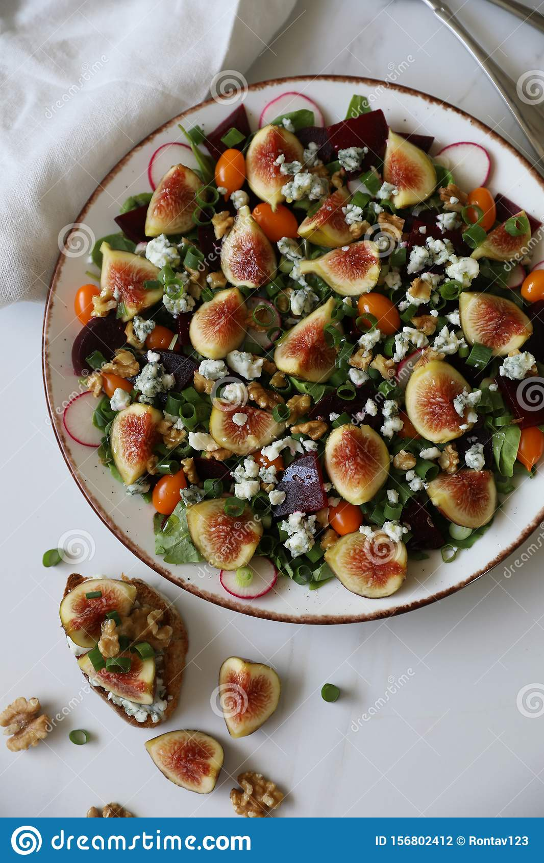 Top view of healthy and delicious fresh Figs,Gorgonzola cheese and beetroot salad